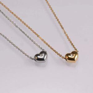 Fashion jewellery heart shape pendant with a shiny white stone