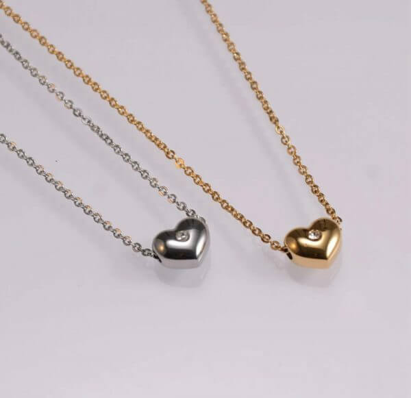 Fashion jewellery heart shape pendant with a shiny white stone